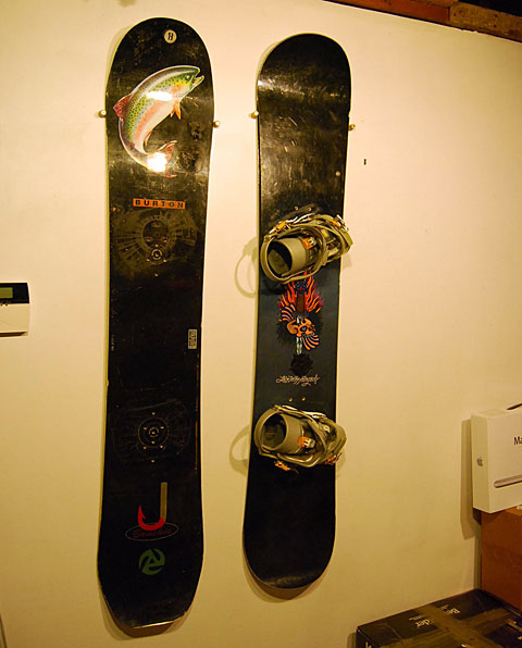 Snowboard storage doubles as decor for Snowboard decor